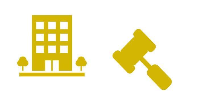 Symboliset keltaisen väriset kerrostalon ja tuomarin nuijan kuvat.
