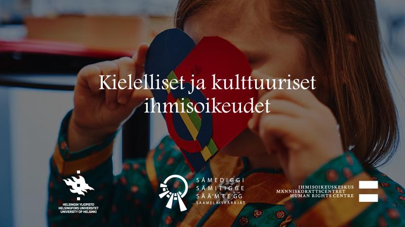 Kielelliset ja kulttuuriset ihmisoikeudet -haastattelun kansikuva, jossa on lapsi saamenpuvussa pitelemässä saamen lipun väreihin askarreltua pahvisydäntä.