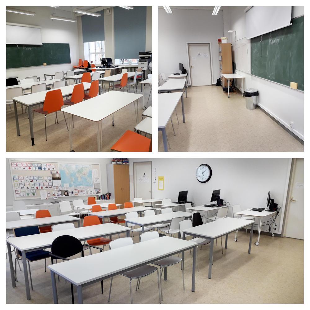 Luokan 205 pöydät ja tuolit ovat aseteltu riveihin liitutauluun päin.